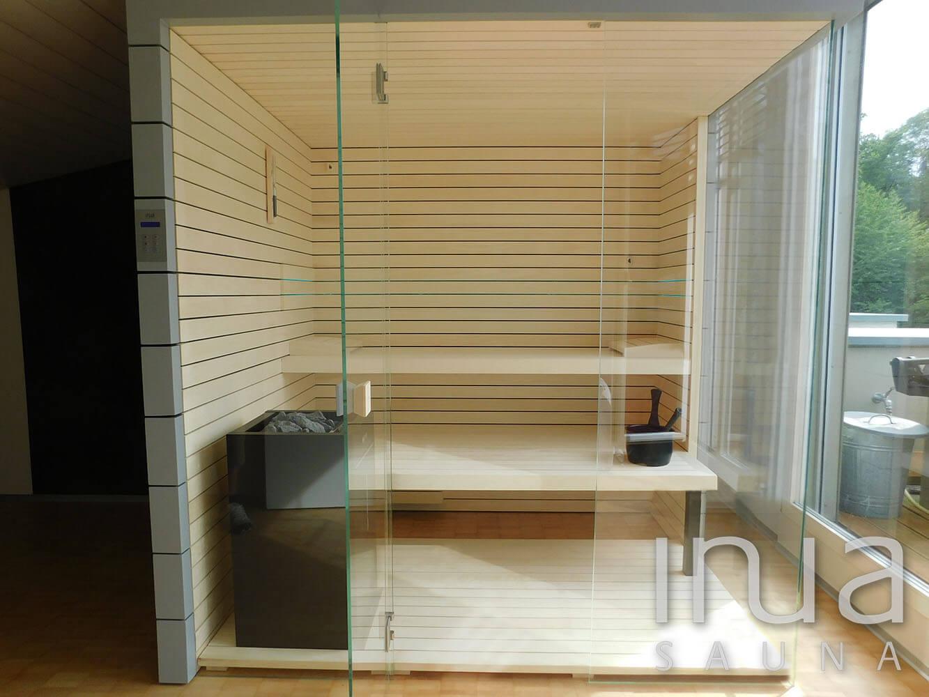 A szauna belső borítása finn rezgőnyárfából készült Inua panelrendszer.