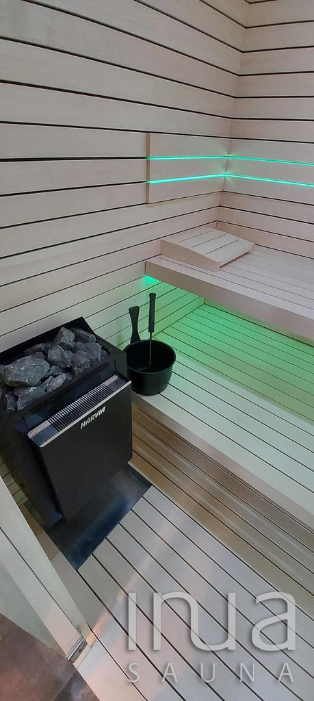 Beépített finn szauna rezgőnyárfa Inua panelrendszerrel.